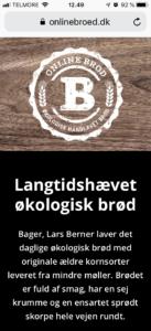 Hjemmeside på mobiltelefon, designet af Lundgrafik